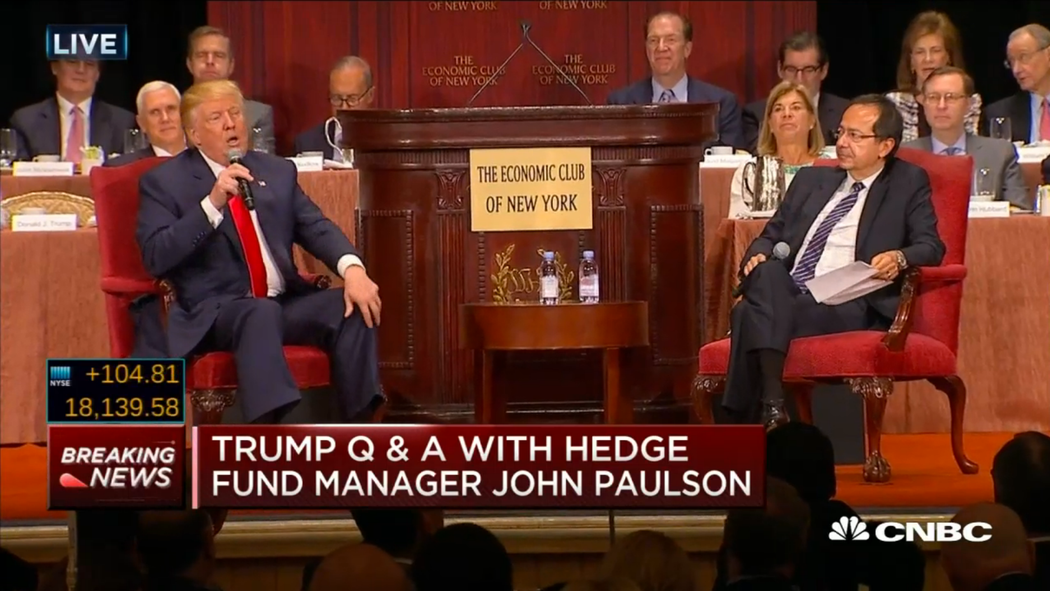 You'd think John Paulson could at least smile, considering how much Trump would like to cut his taxes.